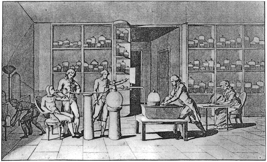 Madame Lavoisier (on the right) while assisting Antoine Lavoisier and his assistant Armand Seguin (in suit at left) on his scientific research of human respiration.jpg