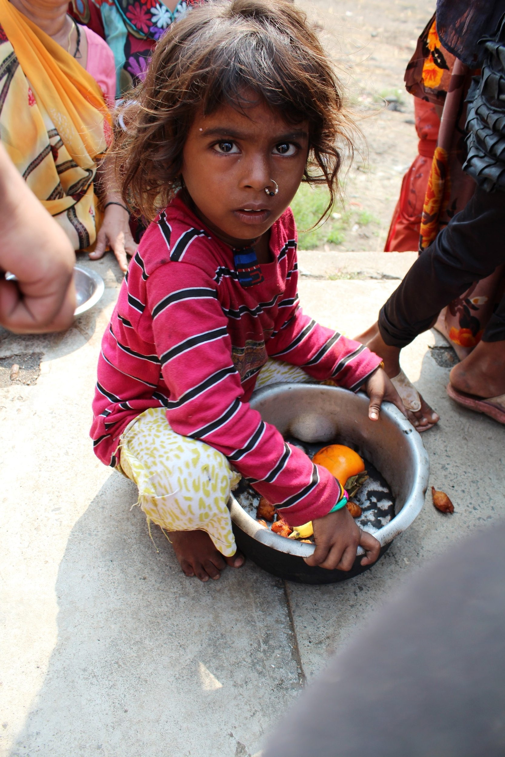 homeless child with donated food to eat.JPG