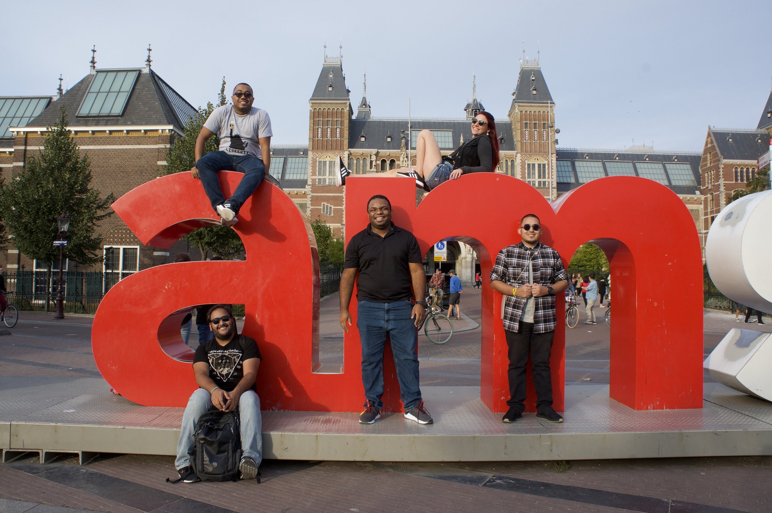 """My Friends on the """"A"""" and """"M"""" of the """"I Amsterdam"""" sign."""