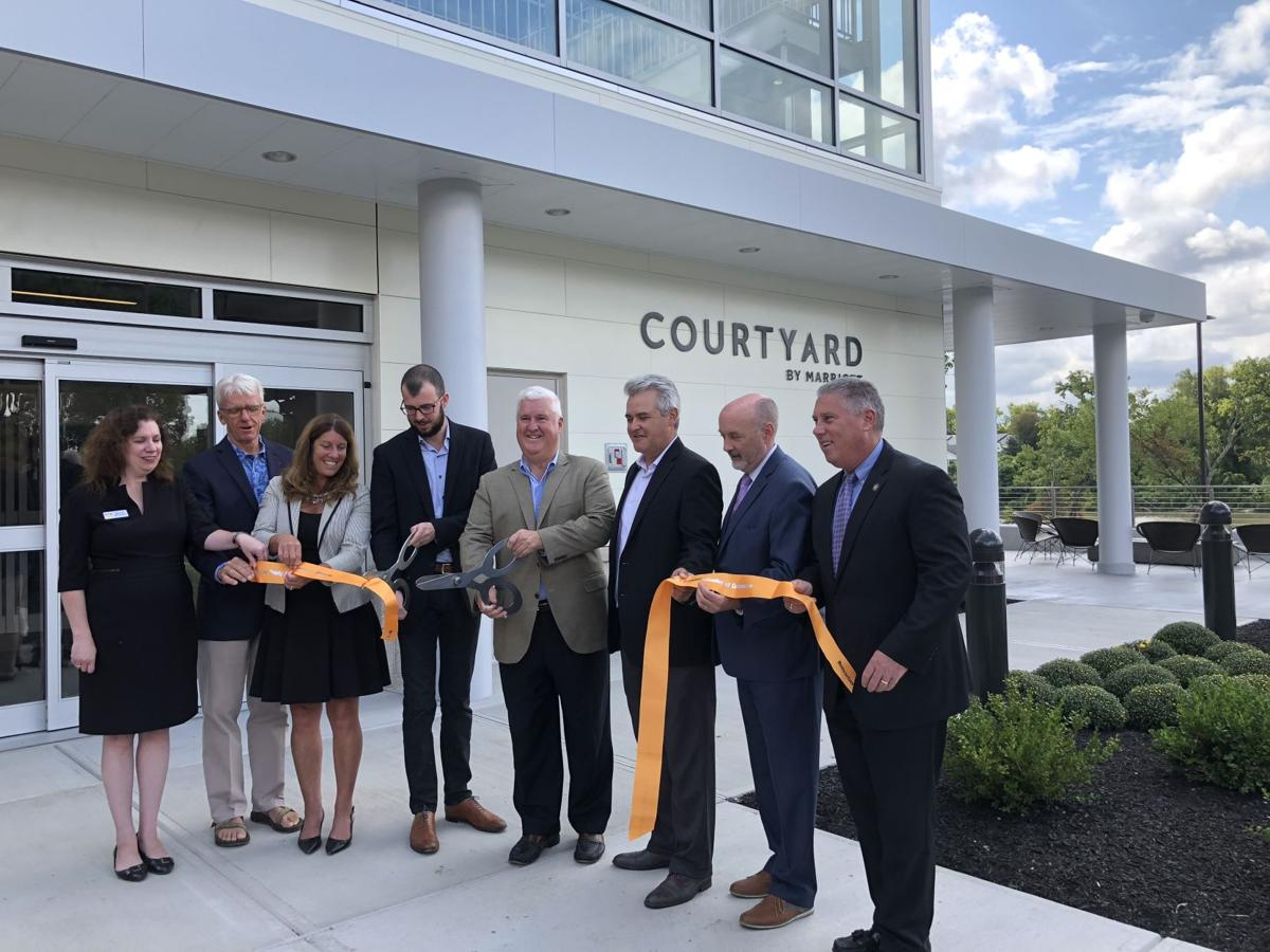 Officials cut the ribbon during an opening ceremony Thursday at the Courtyard by Marriott hotel on River Street in Troy.  Nicholas Buonanno