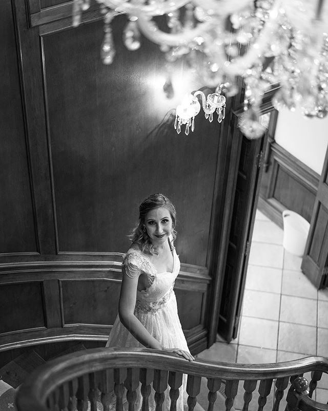 If you come to The Ridge, a portrait under the gorgeous crystal chandelier on the staircase is mandatory. 🧡 Have you visited The Ridge yet? We are located an hour southwest of Oklahoma City and would love to schedule a tour with you! . . . . #oklahomaweddingvenue #theridgeok #weddingphotography #weddingvenues #chandelier #okbride #bridal #christianbusiness #chandelier