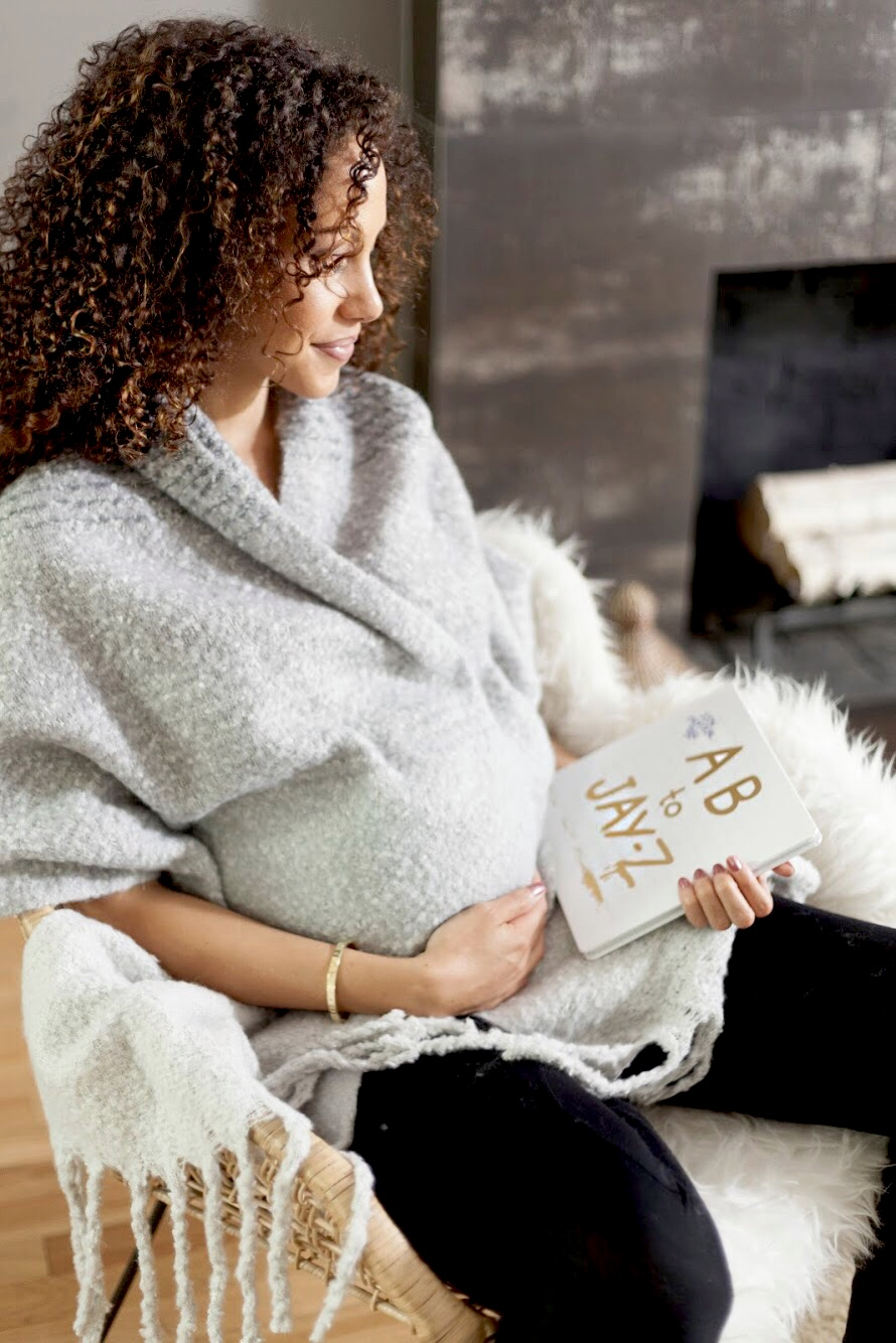 pregnant woman holding AB to Jay-Z childrens book