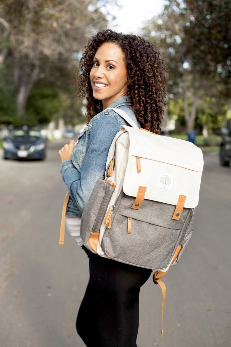 pregnant woman carrying Parker Baby Co. Birch Bag