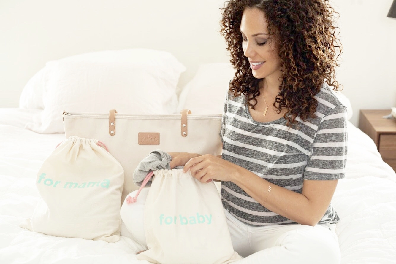mother using YKC totes and diaper bag
