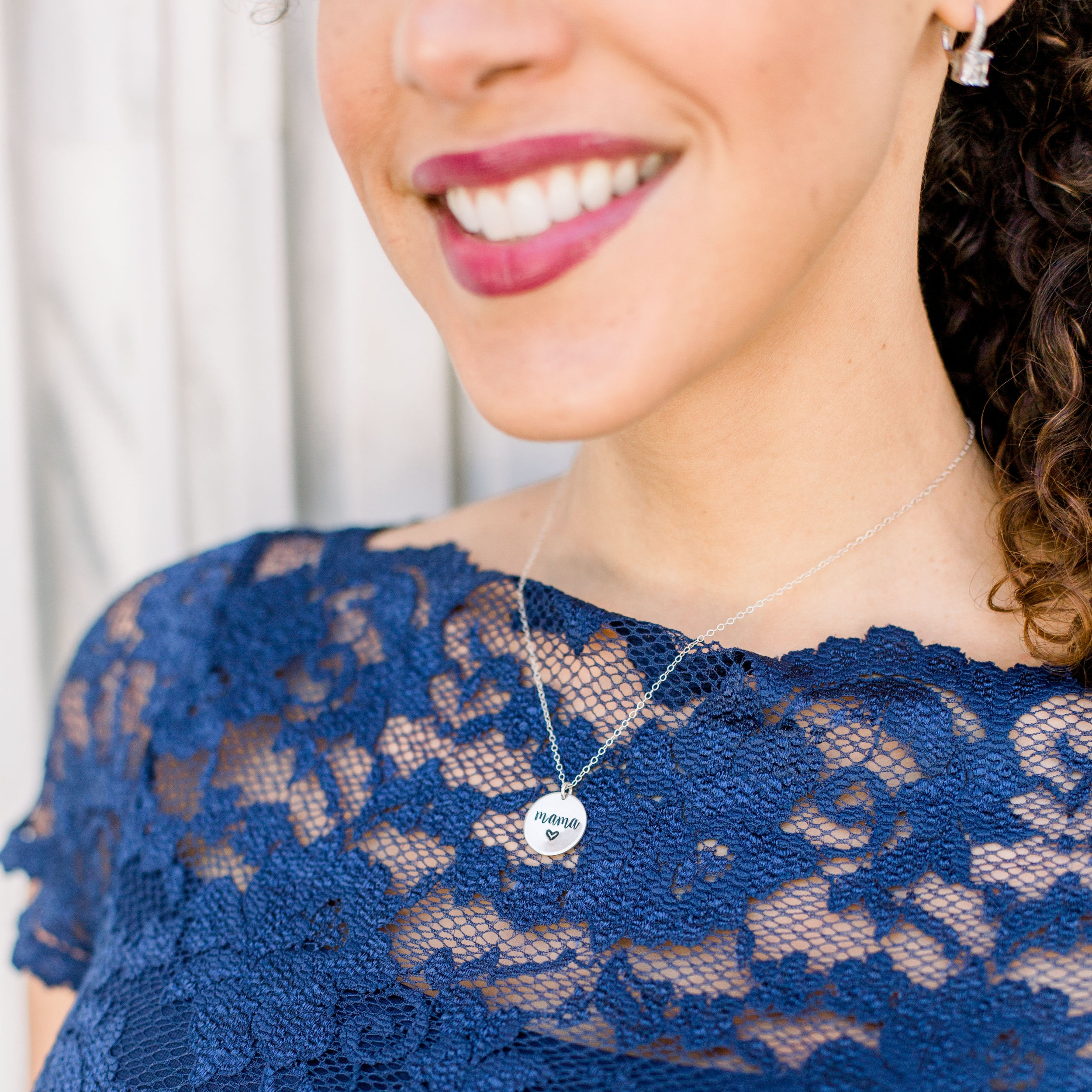 woman wearing silver circle mama necklace from Made With Love By Angie