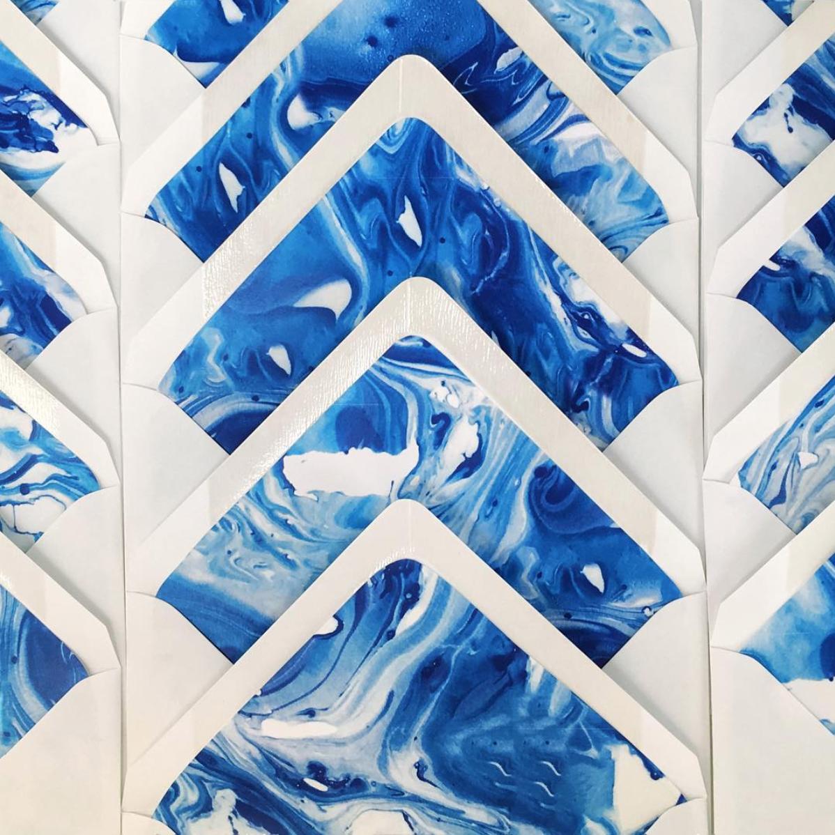 Custom made blue marbled envelope liners.