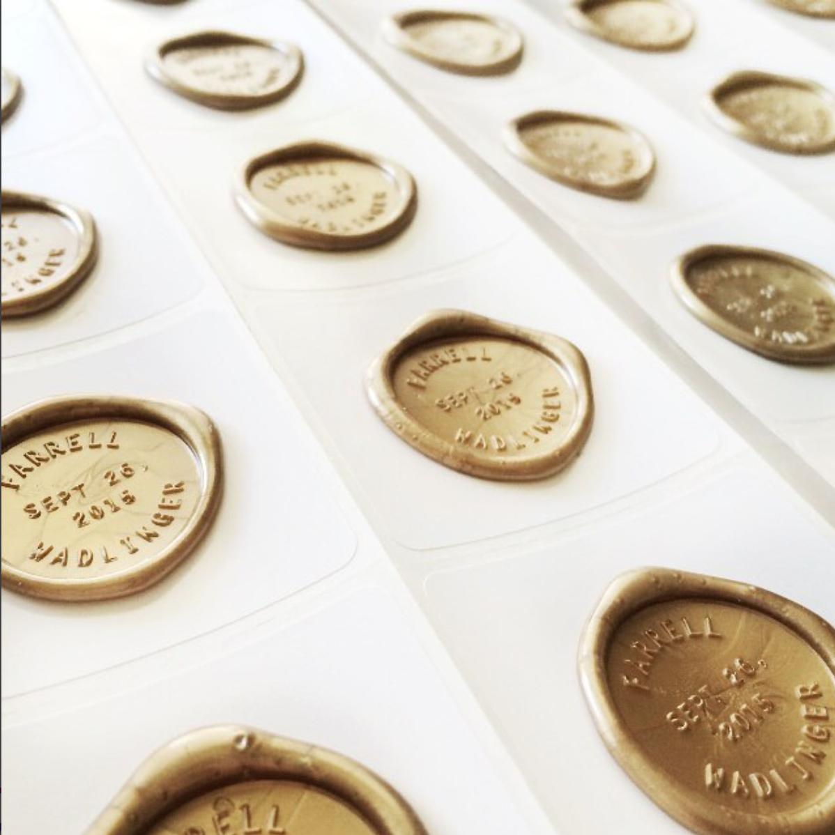Custom gold wax seals for an elegant affair.