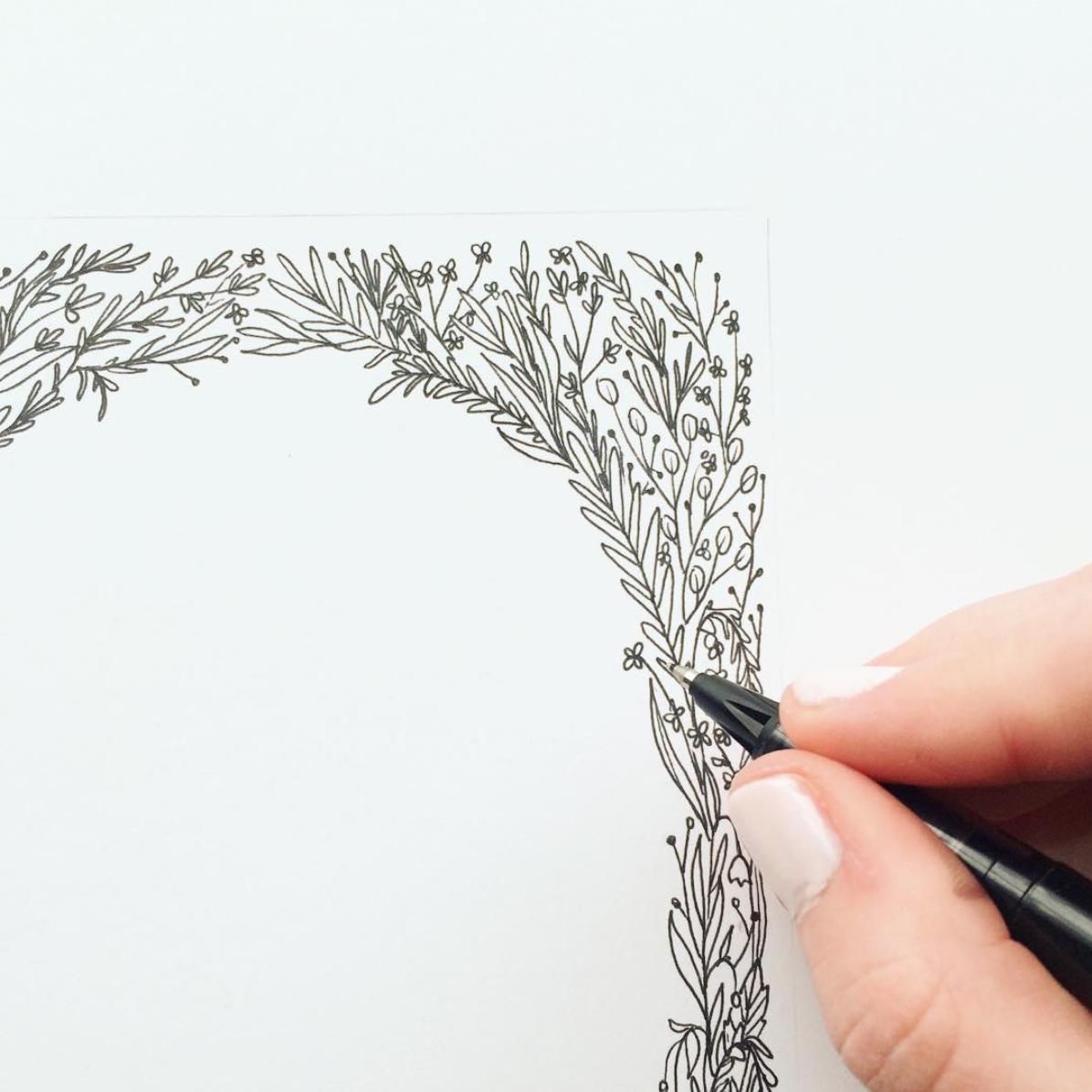 A custom floral border sketch for an invitation.