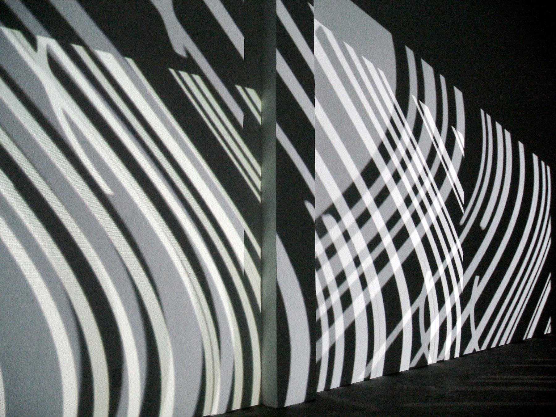 Serpentine, 2007,00:19:30 minute loop,b/w, no audio,h 14 x l 25 x w 10 feet,four video projections, plexiglass