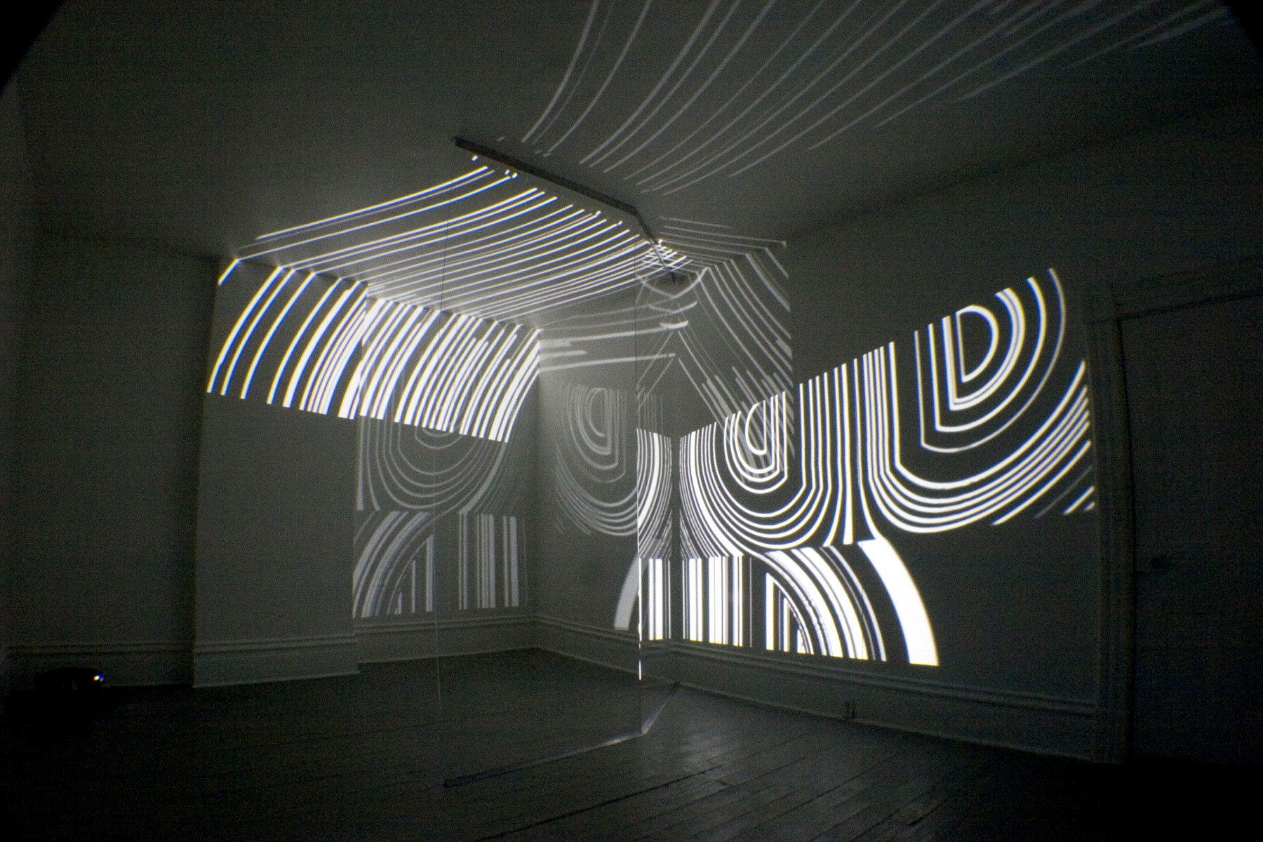 Expanding Magnetic Molten Symmetry, 2006,00:18:00 minutes loop,b/w, no audio,h 10 x l 20 x w 14 feet ,two video projections, plexiglass
