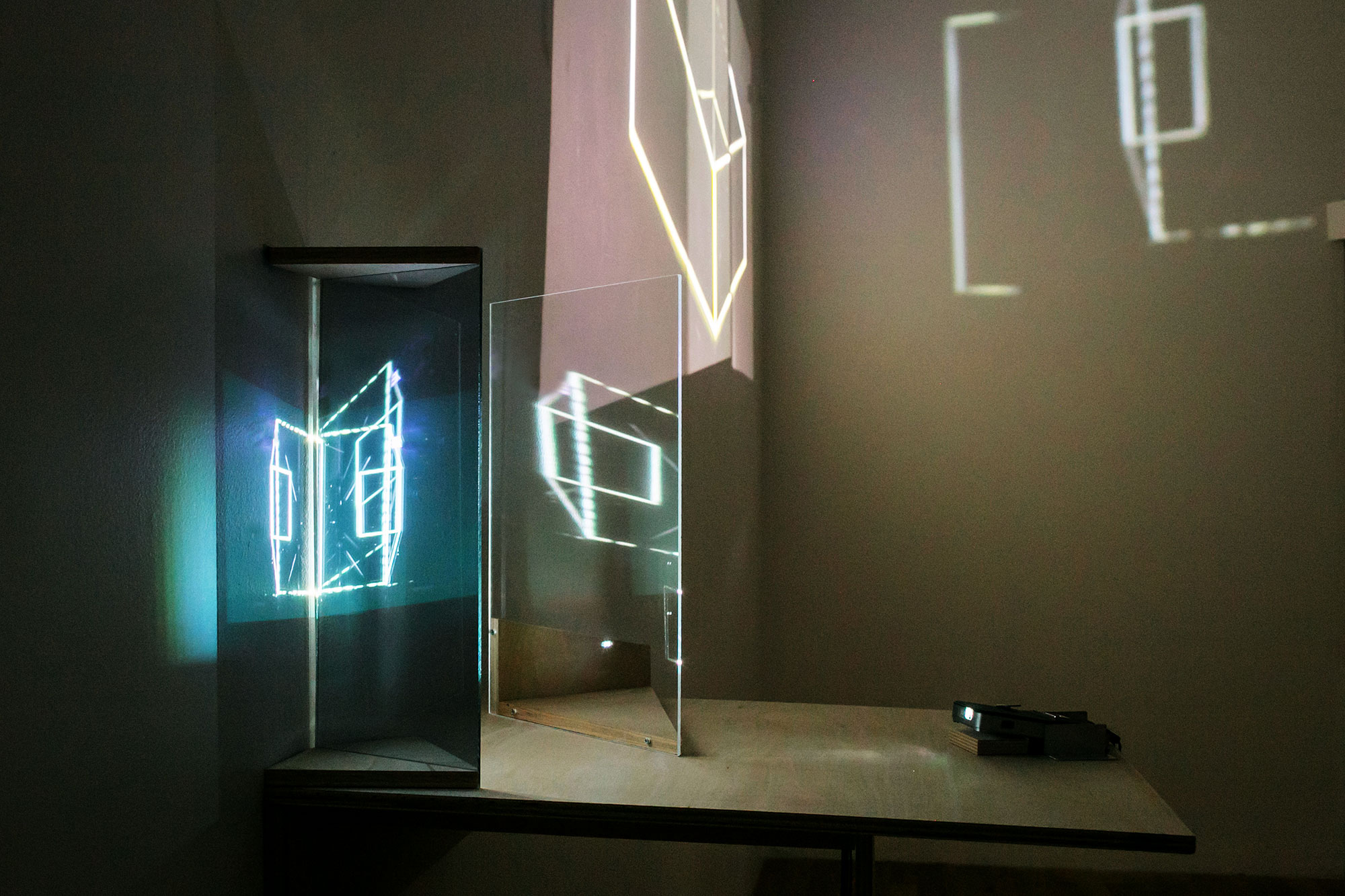 Floating Room (Station Independent), 2013, 00:14:30 minute loop, color, no audio, approximate dimensions: h 15 x l 30 x w 15 feet, two video projections, plexiglass, wood