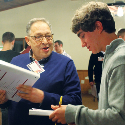 Brother Solvibile (left) working with Collegiate brothers.