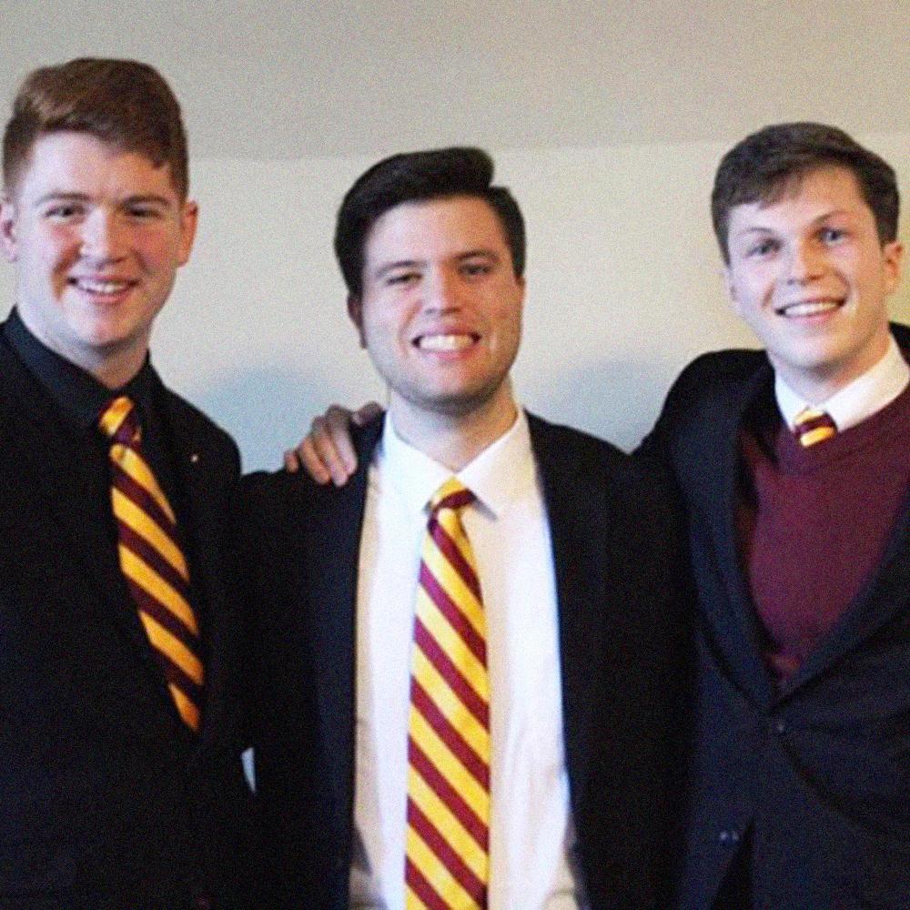 Brother Kyle Bueno (Bridgewater State University, '18) (center).