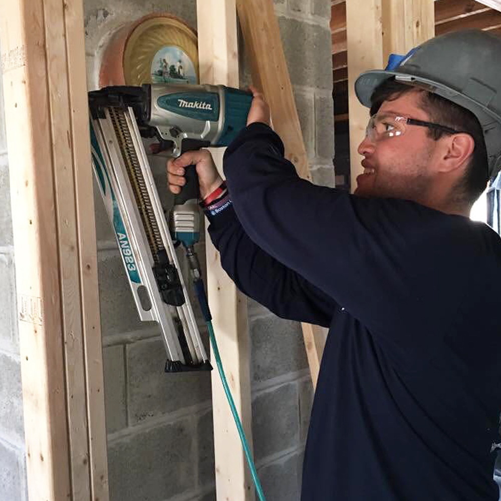 Kyle Bueno helping build a house in Connecticut. Spring 2017.