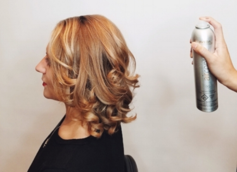2. Lock in the Curls - Keep the curls locked and frizz-free by using Air Control Light Hold Hairspray all over the hair. This will prep the hair for the half-up style we will be doing, as well as add a polished effect to the rest of the curls. *If you kept your hair's natural texture in step 1, make sure to use the Be Curly Curl Enhancer for hold and shine.*