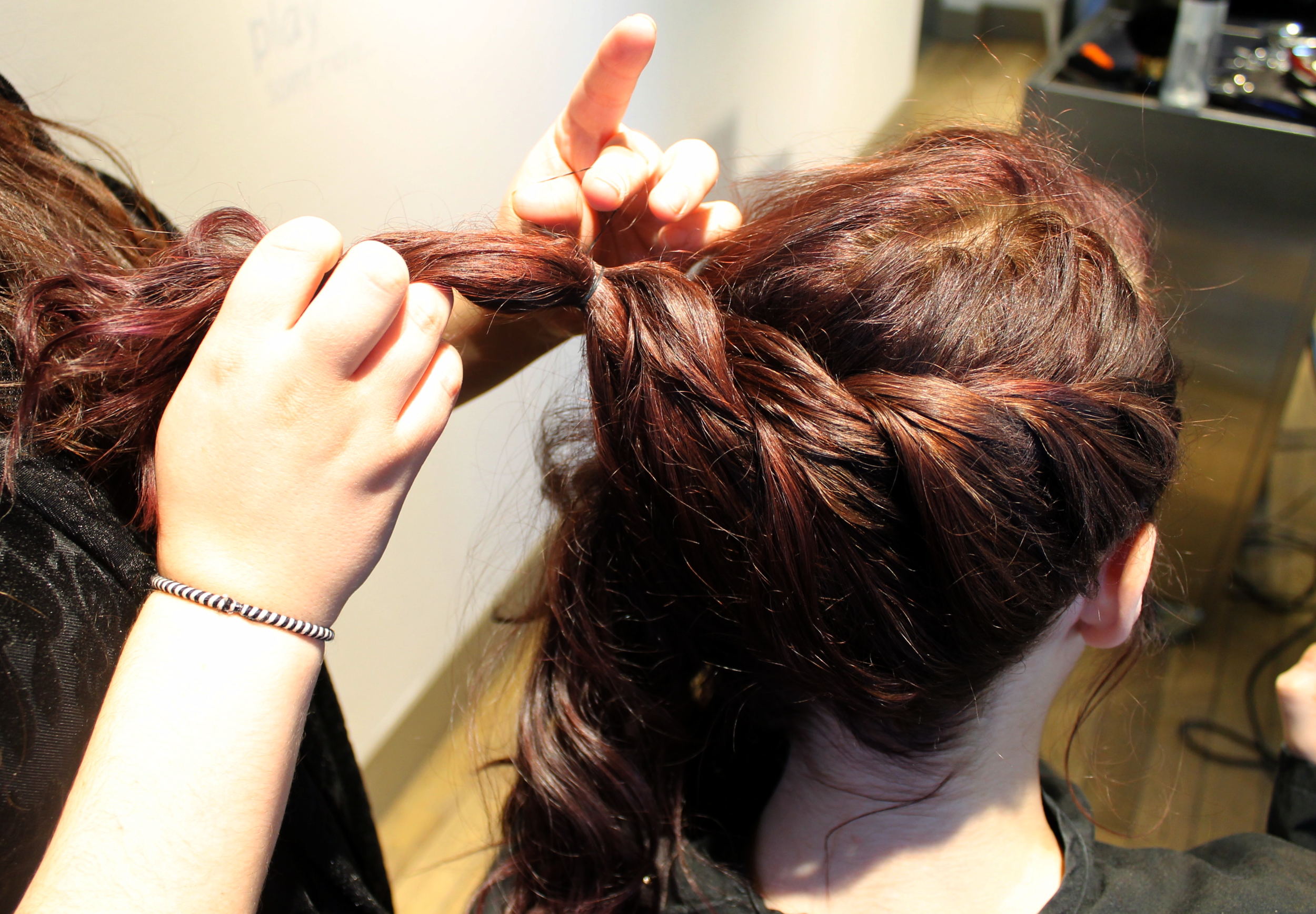 4. Close the Braid - Tie off the rope braid with a small elastic at the center back of the head.