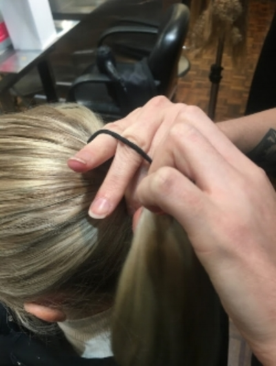 1. Prepare the Hair - Start by prepping hair with Damage Remedy Split End Repair. This will keep fine hairs in place and looking healthy during cold weather that can dry hair out or make it brittle and susceptible to breakage. Put the hair in a ponytail on the back of the head, and wrap a strand of hair around the elastic to hide it. Use a bobby pin to secure.