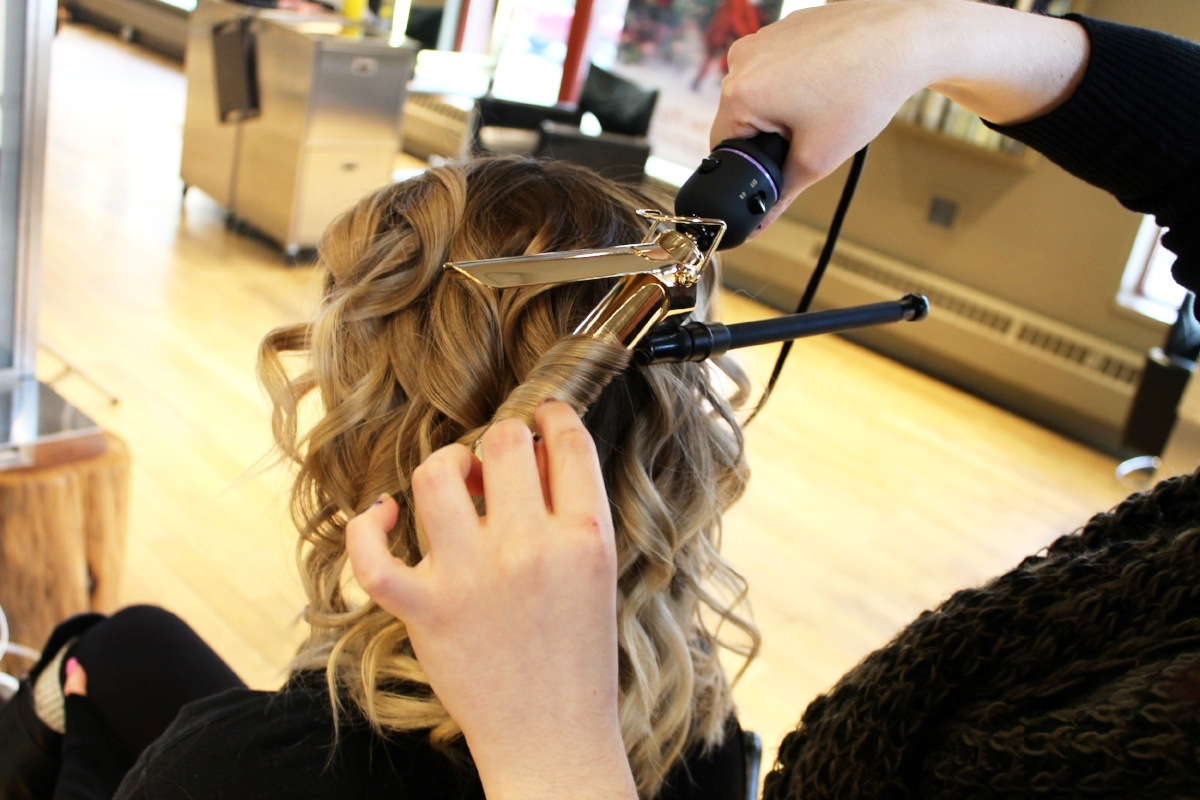 2. Create Waves - Separate hair into 2-3 inch sections horizontally across the back of the head. From those sections, take 1-inch strands of hair and wrap them around the curling iron, keeping the hair flat (like with flat iron curls).*Don't forget to alternate the direction of curls from row to row, curl front sections away from the face, and set curls with Air Control Hair Spray!*