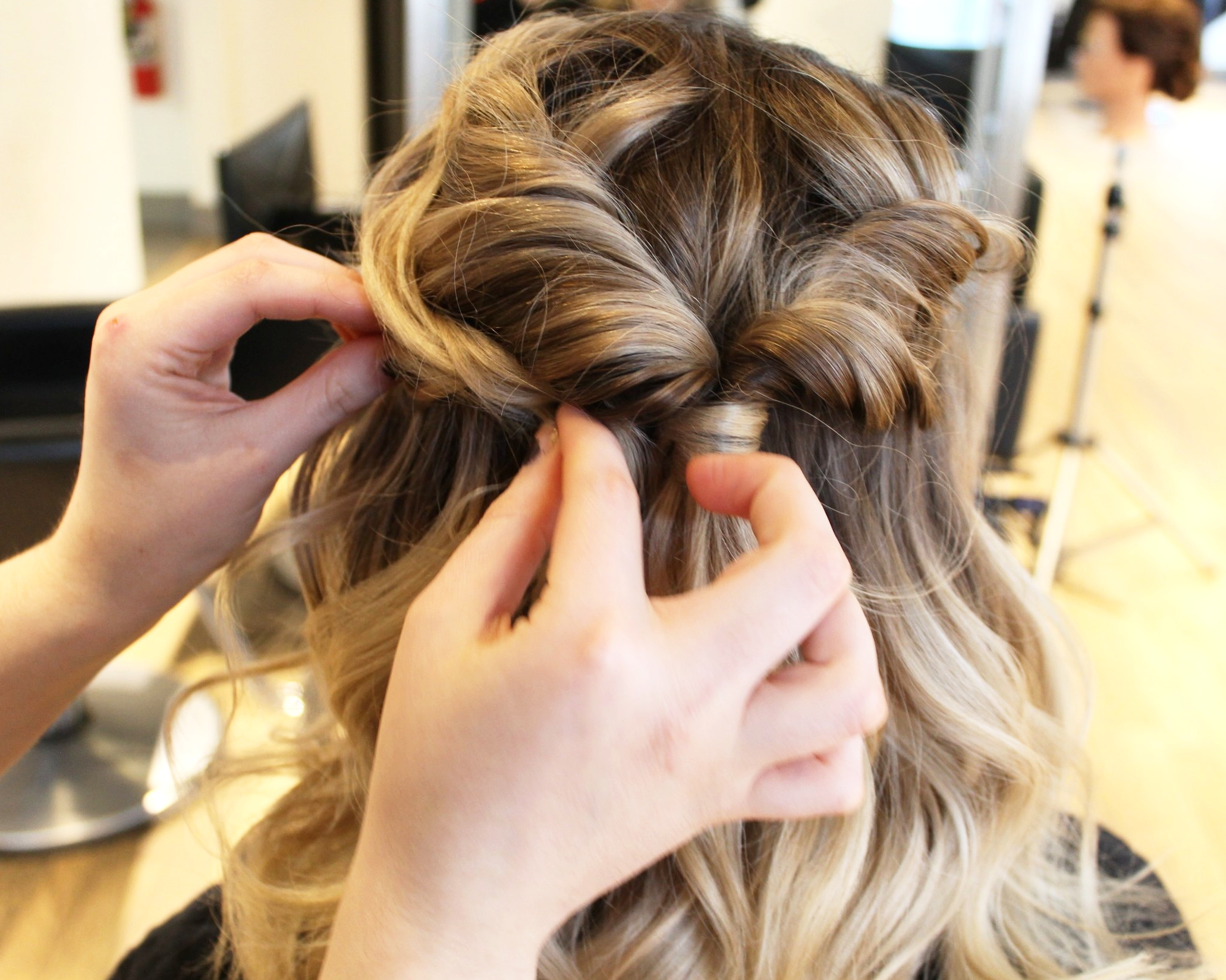 6. Finesse - Pin any loose pieces near the face back into the pony if necessary to refine the look.