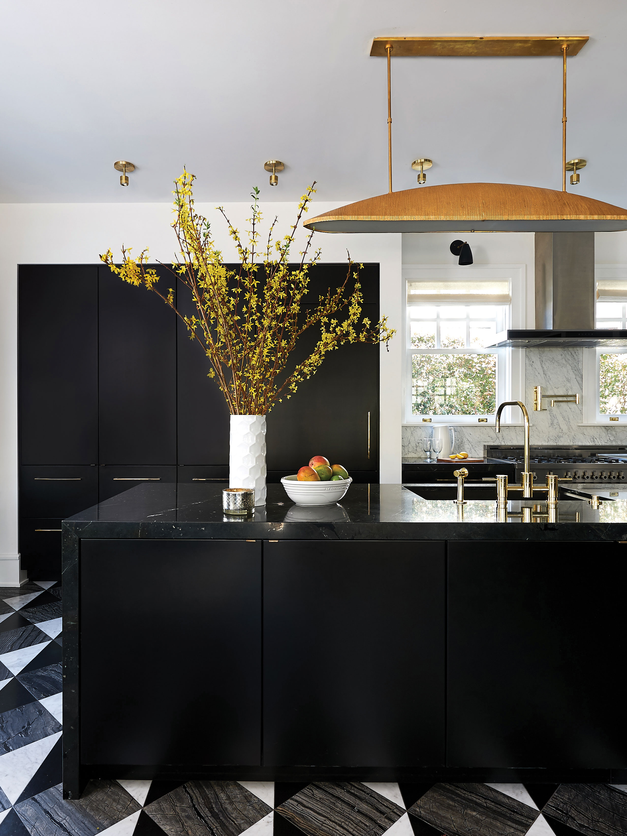 """Kitchen of the Year- -  """"When interior designer Kristin Lomauro-Boom put on her creative hat for her own kitchen, she got to do something a little out there, something glitzier than a typical kitchen. The room is still highly functional, but looks like a glamorous entertaining space from Hollywood's golden age. The flashiness works well with the regency flair of the 1912 Point Loma house that it's in—and the pair of lion statues that greet you at the entrance.""""-San Diego Home and GardenSee article at: https://www.sandiegohomegarden.com/2019/06/13/kitchens-of-the-year-2019-winners-a-golden-age-kitchen/"""