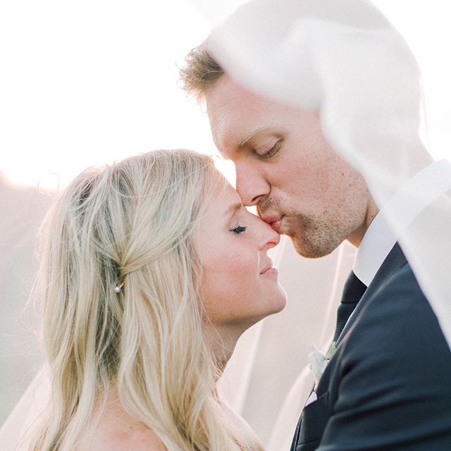 This shot is so sweet - I think a nose kiss might be even sweeter than a forehead kiss! We are so excited for Carli and Calvin's wedding today at the beautiful @maliboulakelodge. Photo credits: planner @starhansenevents via @kelly_patrice. Bride's hair @l_v_r. Bride's makeup @makeupbyhaileyhoff. Venue @cielofarms @robpauerful. 📷 @lucasrossiphoto