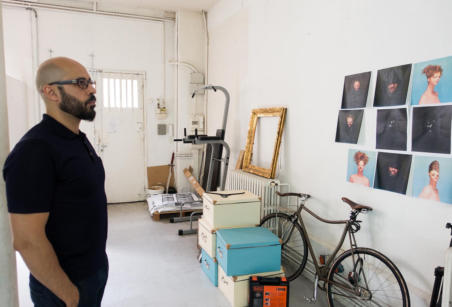 Wahib gazing deeply into his work.