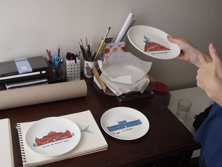 Plates with illustrations of Santiago by Manuela Montero.
