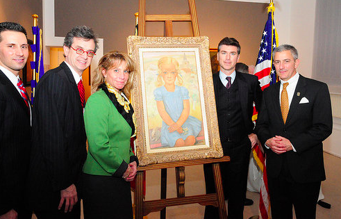 Pierre Vasic (left), son of the family who owned the painting 'Jeune Fille a la Robe Bleue' painted in 1932 by Belgian artist, Antoine (Anto) Carte was present at the ceremony where U.S. Ambassador Howard Gutman (center), and Belgian Minister of Economics, Vincent Van Quickenborne (right), unveiled the painting. Photo: EFE/Benoit Doppagne.