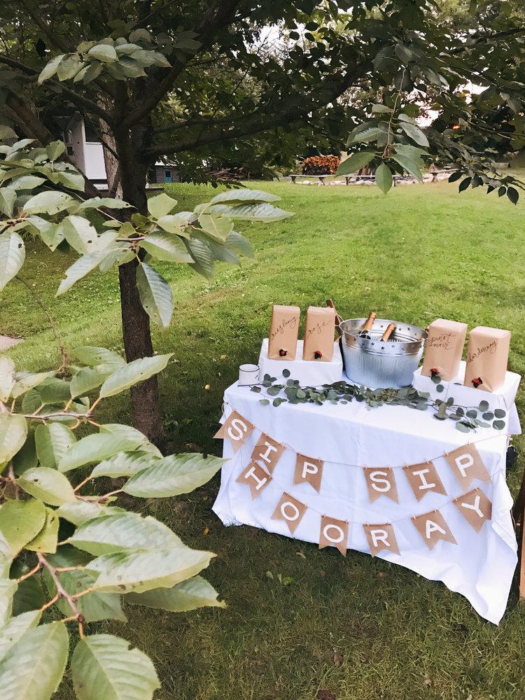 glamping_bachelerette_tablescape_camp_wandawega_wine.jpg