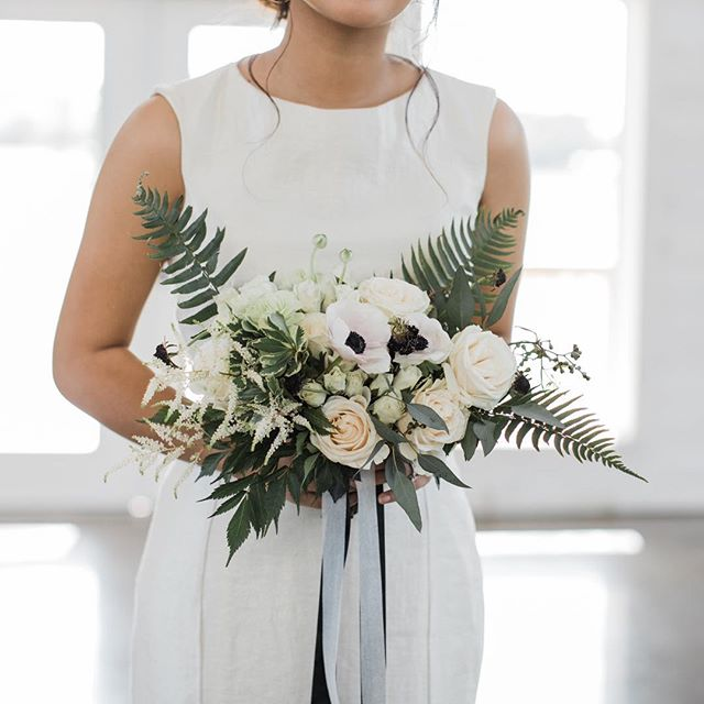 From our minimal monochrome styled shoot.. again thank you to the wonderful vendors who participated.💕 I love the simplicity of this shot! Thank you Bailey 😘  Photographer @opalonyxphotography  Styling/Coordination @michellelippertphoto Venue @wildflowerweddingvenue Florist @davidcoevents Rentals @warehouserose Dress @lisaemerita Cake @mandamobleycakestudio Make up @southernveils Hair @artisticbeautybymariposa Jewelry @monee_elizabeth Stationary @handsofhollis Bride model @syd.nguyen Groom model  @teddeeebear