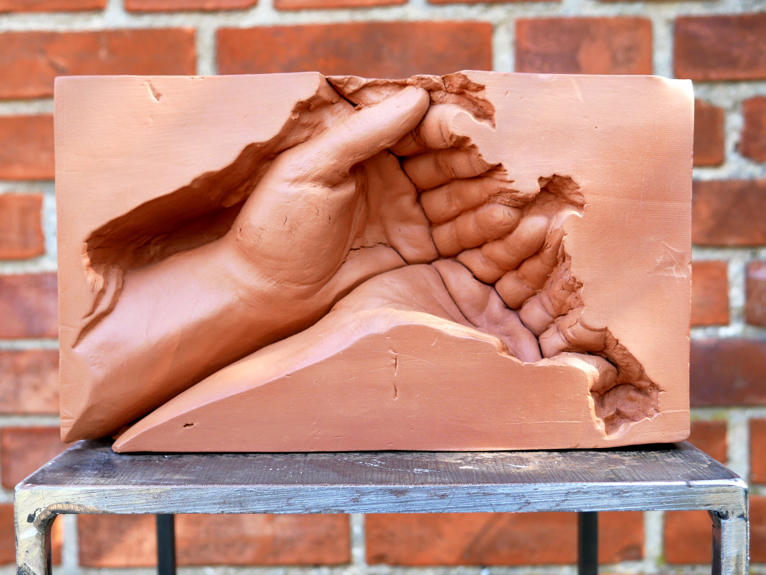 2.Dan Stockholm, By hand, 2018, 24,5x14,5x7,5cm. Unfired red clay.jpg