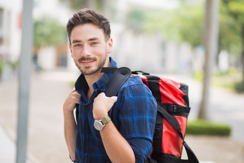 https://www.freepik.com/free-photo/smiling-handsome-traveler-wearing-backpack-in-city_1148041.htm  Designed by Freepik
