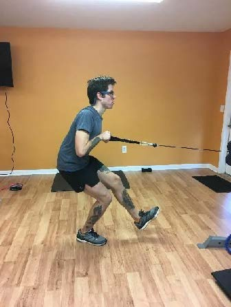 "Forward ""soft"" single leg squat  landing against cable (holding weight for core challenge)"