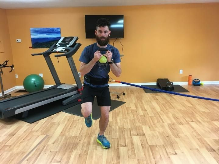 Side to Side Single Leg Hop  using sports cord or cable - hop from one leg, to the side, landing on the other leg CLOSEST TO THE CABLE (holding weight for core challenge)