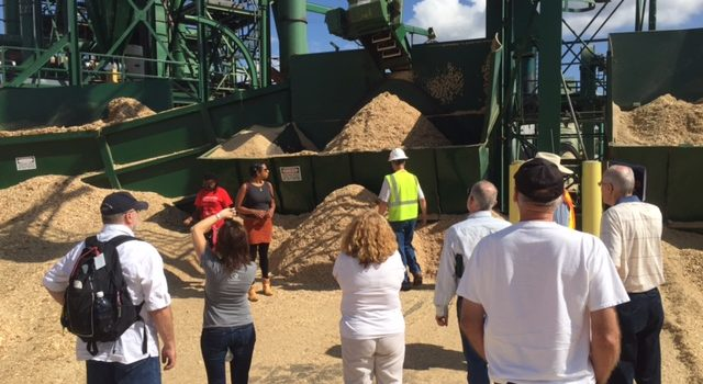 Group of attendees tour Forest Energy Corporation