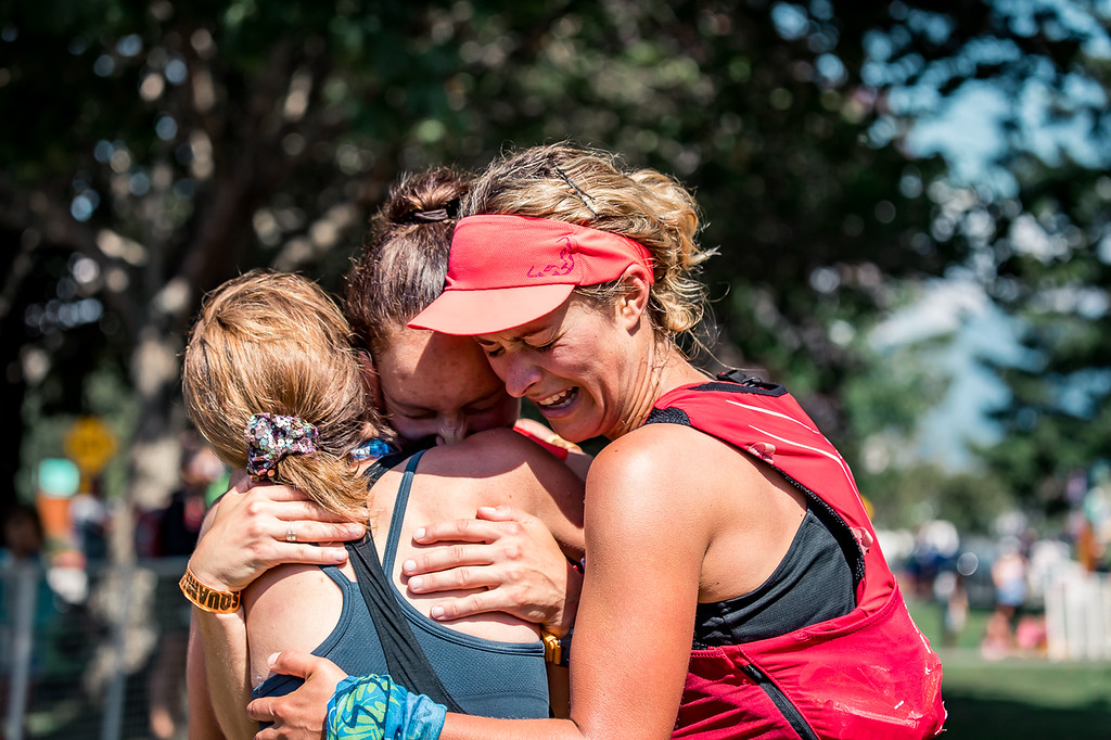 Photo by Hilary Matheson  Hugging first place finisher, Tara Holland and right second place finisher Hailey Vandyk.