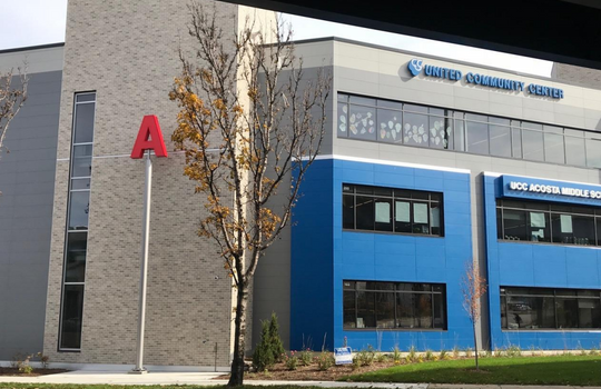 Letters on posts represent aspects of Milwaukee's water. The A at Acosta Middle School could stand for Acosta, aquatic awareness and agua, the Spanish word for water. (Photo: City as Living Laboratory)