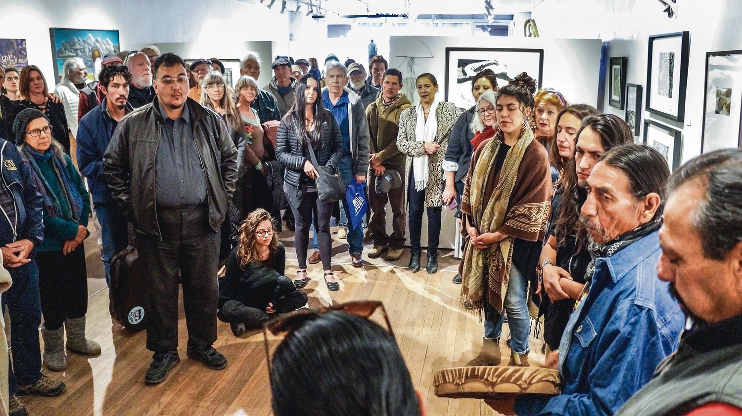The reception on Saturday (April 13) held a rapt audience of supporters when a group of Native singers did a prayer song honoring the power of water. Photo by Rick Romancito/The Taos News