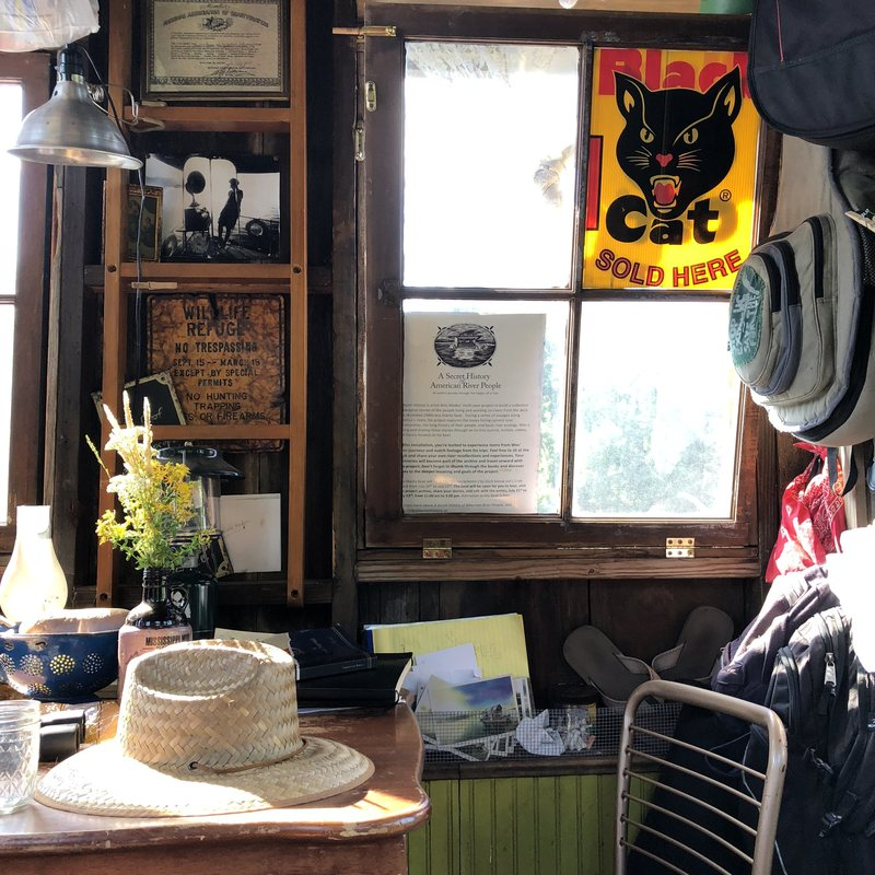 Inside the shantyboat, Modes displays some of the items he has collected from his journeys.  WES MODES/CC BY-NC-SA 2.0
