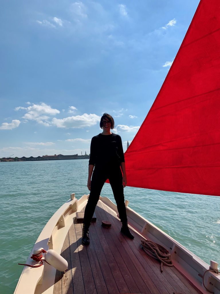 Melissa McGill with one of the boats for her project  Red Regatta . Photo by Sarah Cascone.