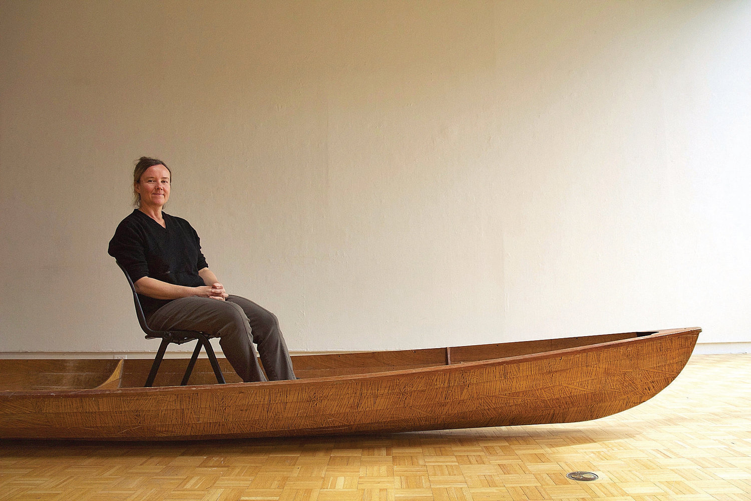 Marie Lorenz sits for a portrait in one of her handmade boats that she uses to explore urban waterways, collect trash and experience the world. Lorenz's work was exhibited in the Suzanne Lemberg Usdan Gallery at Bennington College earlier this spring in preparation for Lorenz and gallery director and curator, Anne Thompson, to travel down the Hoosic and Hudson rivers all the way to New York. Photo by Elodie Reed.