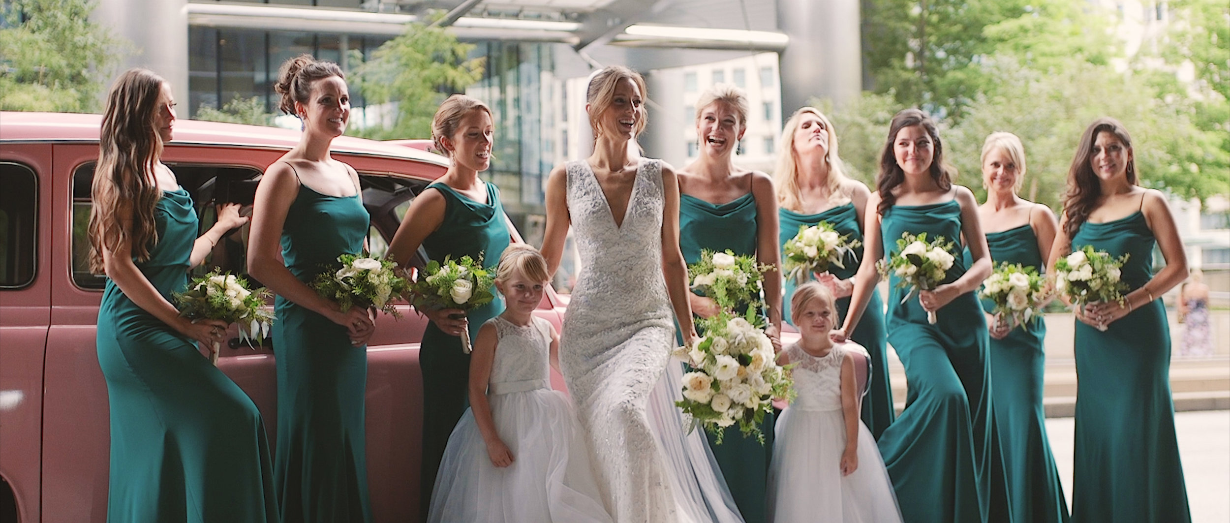 Bride and bridesmaids at the Langham Chicago before downtown wedding reception at the Field Museum. Chicago Wedding Videographer