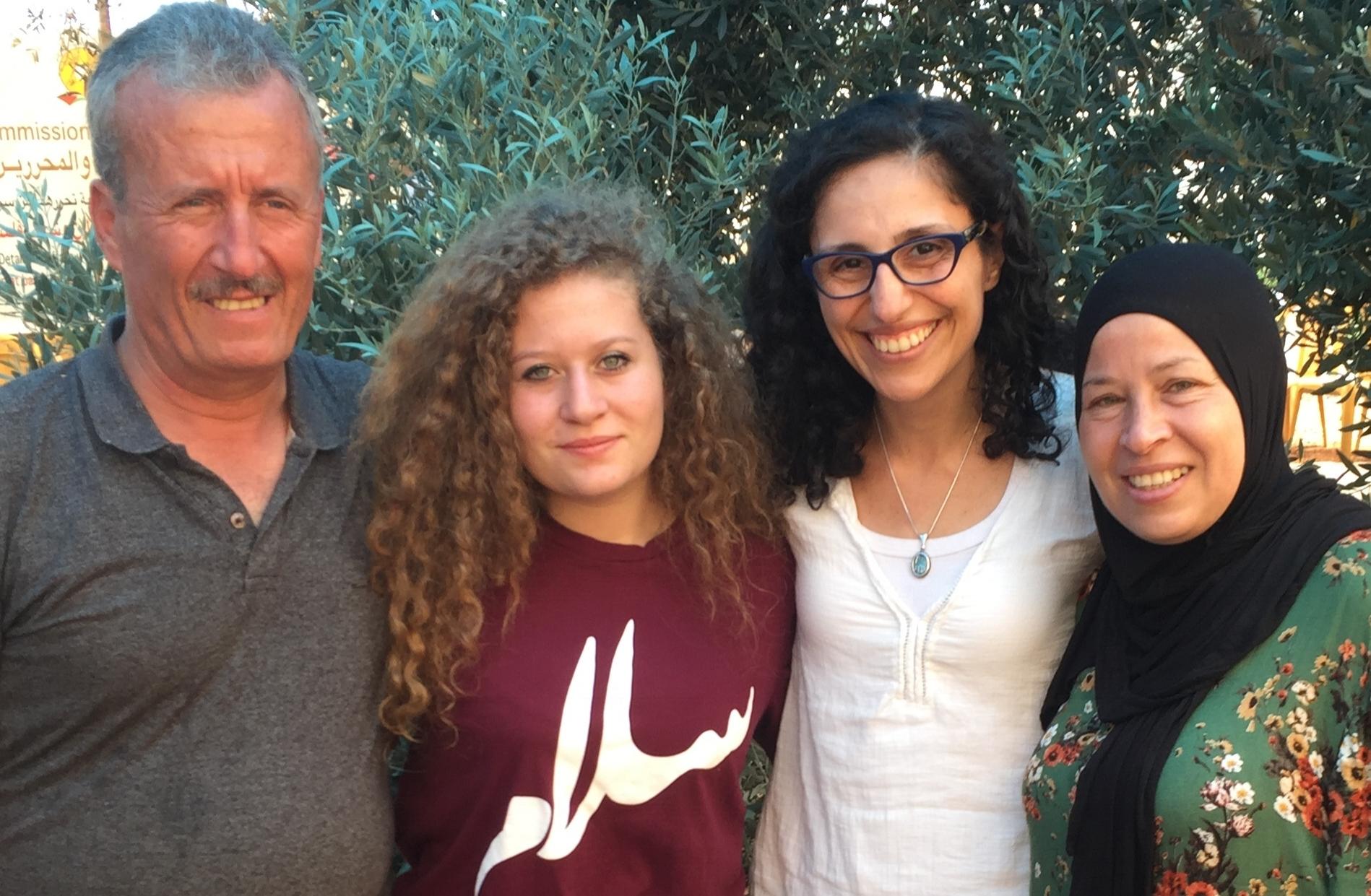 Eyewitness Palestine's Managing Directer, Nada El-Eryan, with Bassem, Ahed, and Nariman Tamimi during a delegation visit to Nabi Saleh.
