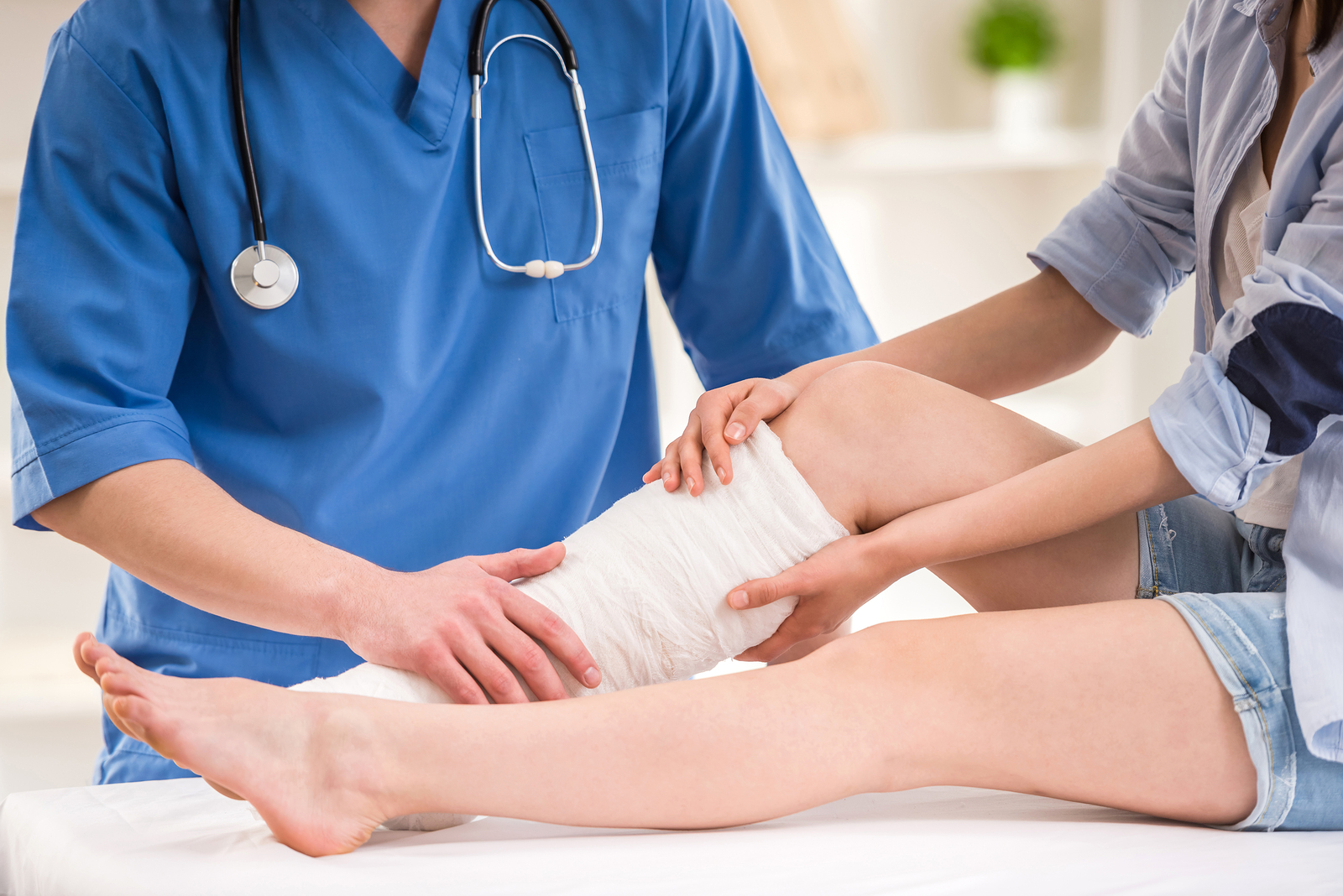 Doctor bandaging leg.jpg