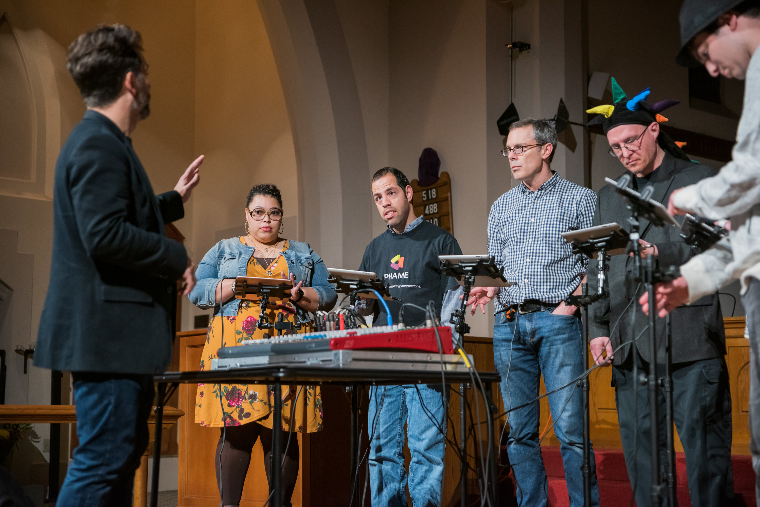 PHAME Director of Arts & Education, Matthew Gailey, conducts the iPad Ensemble. The iPad Ensemble will serve as the orchestra for the production, and will be joined by a string quartet comprised of students from Metropolitan Youth Symphony.