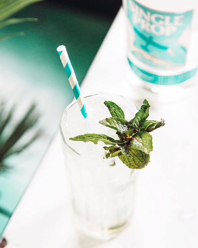 Take a sip of the 'Clean Ocean Water' mojito, our signature #WorldOceansDay cocktail, and feel the island breeze push you towards adventure. If you're inspired by Caribbean flavors, create an ocean-inspired cocktail of your very own with Single Prop Rum and tag us for a chance to win a special gift! 🌴 . . . #mojito #cleanoceans #4ocean #plasticfreeoceans #caribbeanrum #rumdrinks #summerdrinks #rumlovers