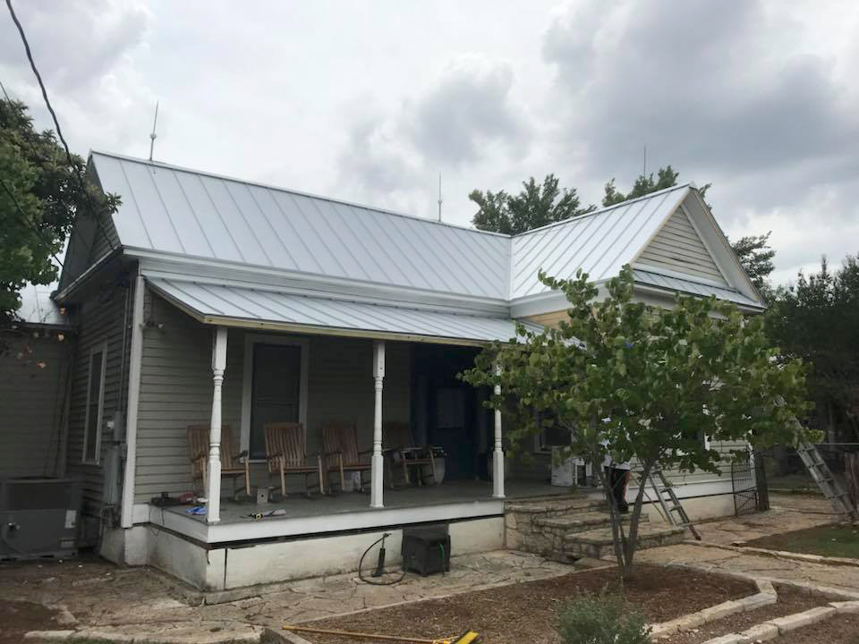 Vintage Metal Roofing Systems by Tomlin Roofing Professionals in San Antonio.