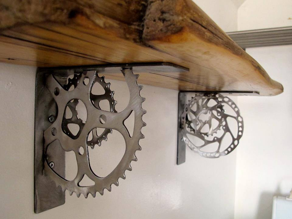 Giving 'em the grind - These shelf brackets are made from old salvaged gear rings.  Available for custom orders with or without wood shelf.
