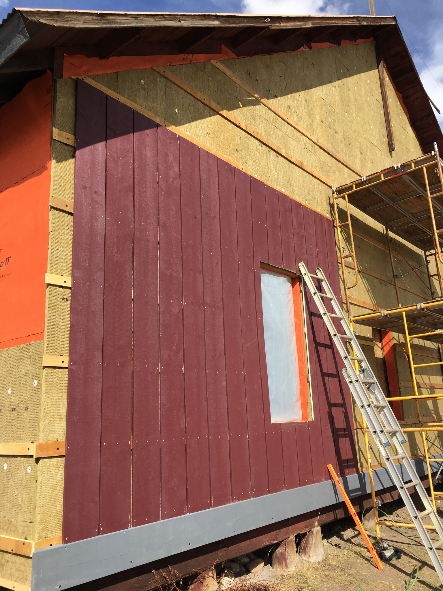 Using the rough edge of new siding brings the texture and feel of the original siding while adding material integrity.