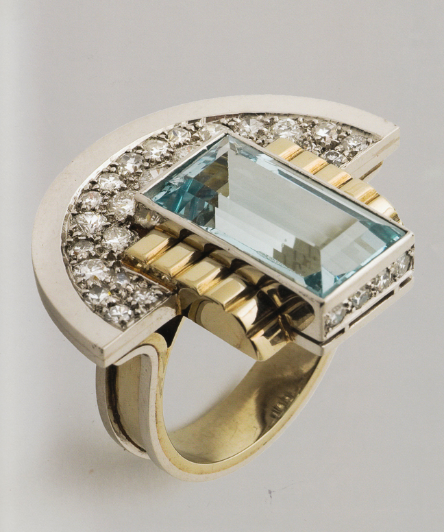 Art Deco Jewelry: ring designed circa 1930's by Jean Després. Despres  was a French jewelry maker and designer best known for his intricate Art Deco jewelry made from semi-precious stones, machine parts, and enamel. His jewelry is the perfect mix of the luxury and machinery aesthetic.